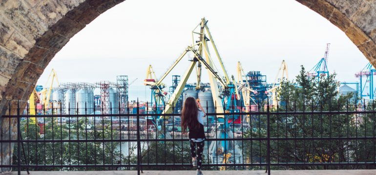 little-girl-playing-at-fence